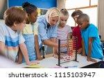 teacher teaching children math...   Shutterstock . vector #1115103947