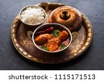 indian dish spicy chicken curry.... | Shutterstock . vector #1115171513