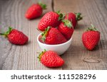 close up of strawberry on wooden background - stock photo