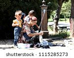 refugees and migrants in a... | Shutterstock . vector #1115285273