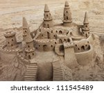 A beautiful sand castle on a beach. - stock photo
