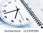 Clock face, calendar and diary page - stock photo
