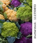 Pile of Purple Green Orange Cauliflower at the farmers market - stock photo