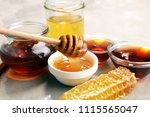pouring aromatic honey into jar ... | Shutterstock . vector #1115565047