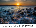 dramatic sunset on the sea with ... | Shutterstock . vector #1115587637