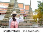 young woman traveling... | Shutterstock . vector #1115634623