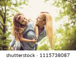 smiling single mother playing... | Shutterstock . vector #1115738087