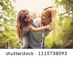 smiling single mother playing... | Shutterstock . vector #1115738093