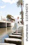 beautiful young tourist woman... | Shutterstock . vector #1115764373