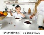 mother feeds her cute little... | Shutterstock . vector #1115819627
