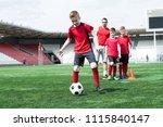 full length portrait of junior... | Shutterstock . vector #1115840147