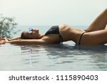 sexy woman relaxing in the pool ... | Shutterstock . vector #1115890403