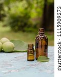Small photo of Walnut oil in a bottle and green nuts. Selective focus