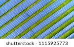 solar panels in aerial view | Shutterstock . vector #1115925773