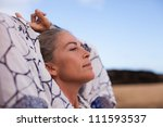 beautiful woman out in nature...   Shutterstock . vector #111593537