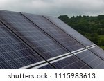 photovoltaic panels on a cloudy ... | Shutterstock . vector #1115983613
