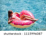pretty woman lying on floating... | Shutterstock . vector #1115996087
