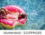 pretty woman lying on floating... | Shutterstock . vector #1115996183