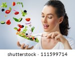 A beautiful girl eating healthy food - stock photo