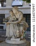 """Small photo of Paris / France - June 29, 2010: a Sculpture of Eugène Delaplanche """"Maternal Education"""""""