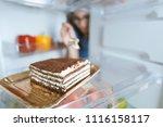 hungry woman eating a dessert...   Shutterstock . vector #1116158117