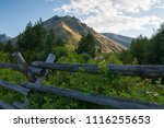 A Wooden Rail Fence With A Sid...