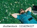 tired freelancer lying on grass ... | Shutterstock . vector #1116256127