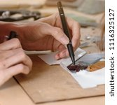 mosaic master working on new... | Shutterstock . vector #1116325127