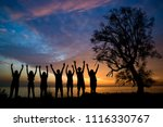 Silhouette Of Young Peoples In...