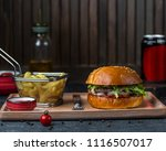 cheeseburger and fries with... | Shutterstock . vector #1116507017