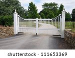 Gates and Driveway of a Country Estate - stock photo