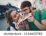 happy couple sharing pizza on... | Shutterstock . vector #1116623783