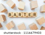Small photo of Barter word on wooden cubes