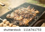 cooking mushrooms and meat on... | Shutterstock . vector #1116761753