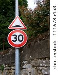 Small photo of sign with hump and 30 speed limit