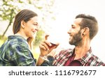 happy young couple drinking red ... | Shutterstock . vector #1116792677