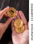 gold bitcoin in hands at the... | Shutterstock . vector #1116848543