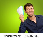 a young man holding tickets on... | Shutterstock . vector #111687287