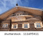A facade of traditional russian wooden house - stock photo