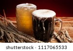 two glasses brown and golden... | Shutterstock . vector #1117065533
