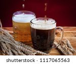two glasses brown and golden... | Shutterstock . vector #1117065563