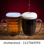 two glasses brown and golden... | Shutterstock . vector #1117065593