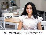 pretty  dark hair girl in white ... | Shutterstock . vector #1117090457