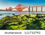 Coast at low tide near the Firth of Forth Bridge in Scotland - stock photo