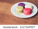 colorful french macarons on... | Shutterstock . vector #1117169957