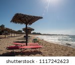 sunshades on the beach at... | Shutterstock . vector #1117242623
