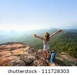 young backpacker standing on... | Shutterstock . vector #111728303