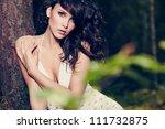 beautiful girl in a wild forest - stock photo