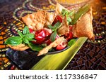 delicious salad with nachos and ... | Shutterstock . vector #1117336847