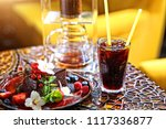iced coffee and cake on summer... | Shutterstock . vector #1117336877